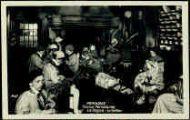1 vue  - Les Caras Pérozards-La Vogua 'La Veillée' [les enfants sont tous de Pérouges, le vielleux est bressan, 1942] (ouvre la visionneuse)